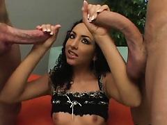 Cute Mexican slut sucks on two major cocks