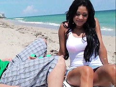 Hot latina in a sexy white shirt on the beach