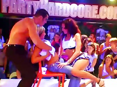 Group amateur dancing and undressing on club stage in public