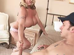 Super large tits get titty fucked on the bed