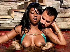 Black hottie shows some tits in the pool
