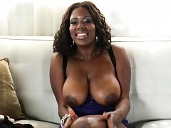 Hot ebony slut loves it when her natural tits get oiled up