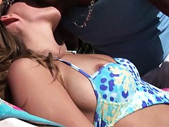 Hot brazillian babe tans and gets some male attention