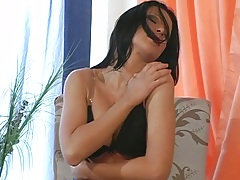Brunette hot babe Tera Bond showing her big tits and inserting dildo