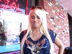 Busty blonde slut walks thru the store