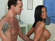 Doctor pumping Angelika from behind on a stool