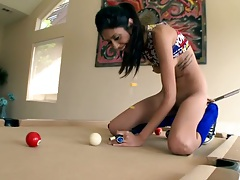 Solo cutie Angel Del Rey on pool table shooting balls