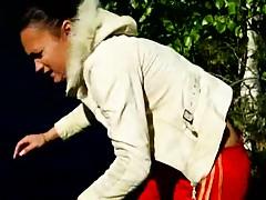 Teen is exposing her body outdoors in the park