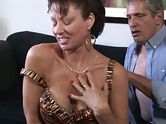 Undressing milf Vanessa Videl moves down to suck mans penis
