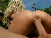 Cowgirl fucking and cock sucking outdoors with a blondei